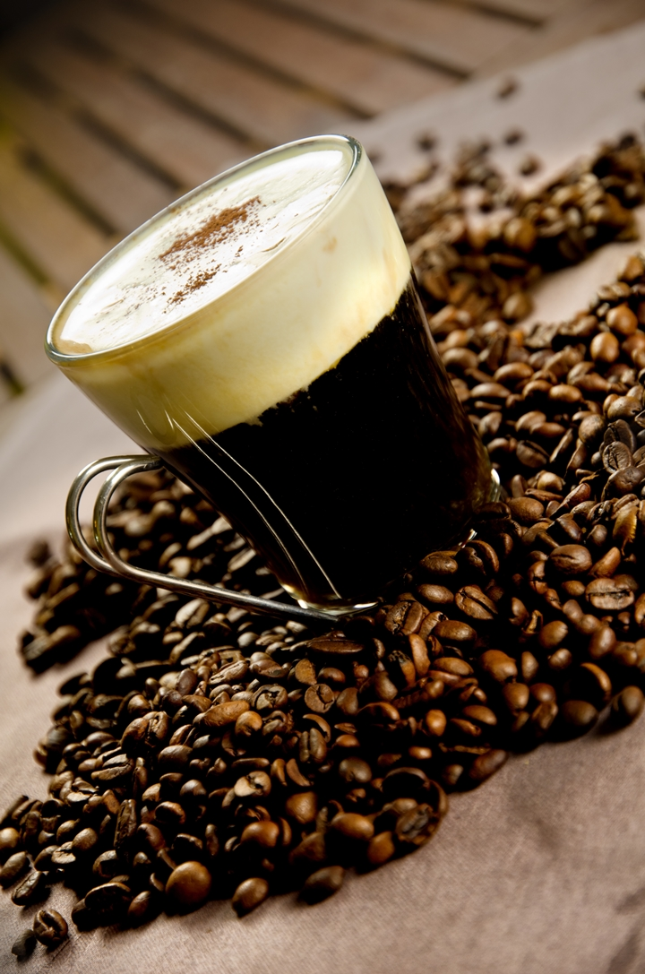 Warm Irish Coffe with coffee beans, whiskey and cream
